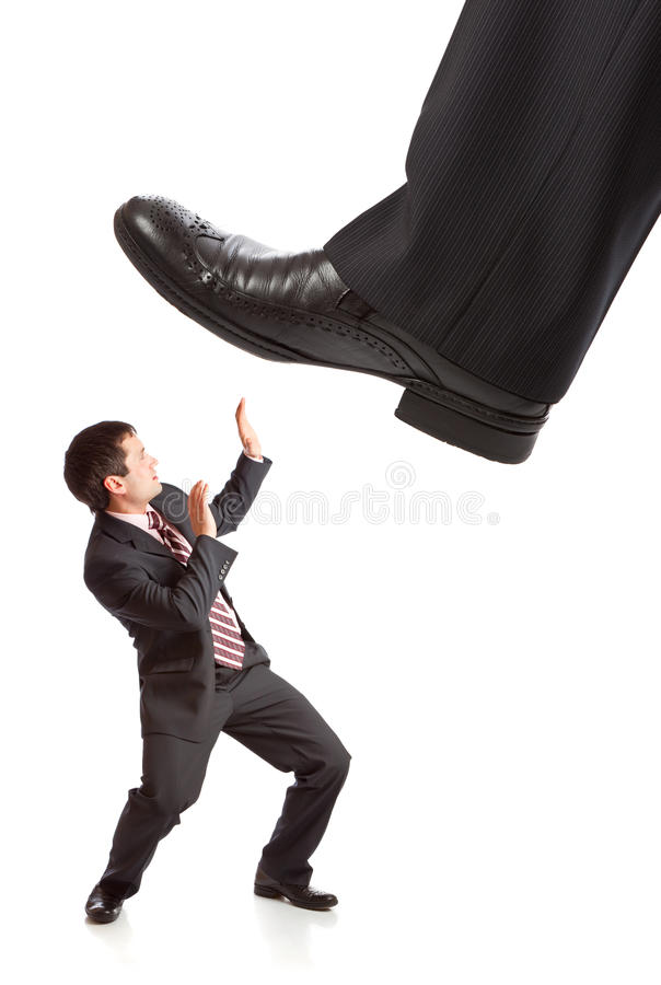 Download Businessman's Foot Stepping On Tiny Businessman Stock Photo - Image: 13540154