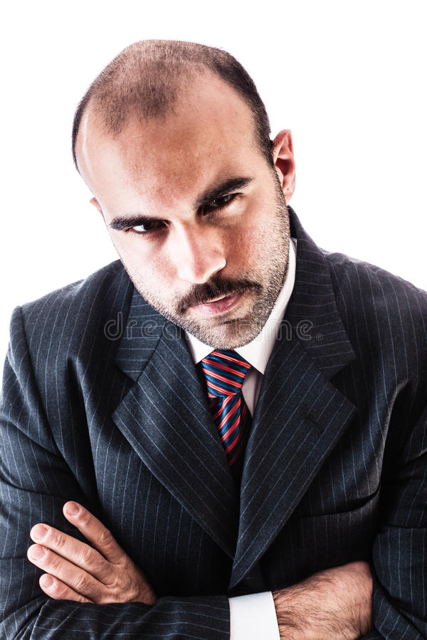 Businessman's glare. Portrait of a classy businessman wearing a suit isolated over a white background royalty free stock image