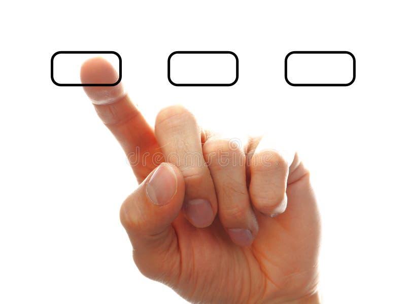 Businessman?s Hand, die eine der Optionen chooising ist stockfoto