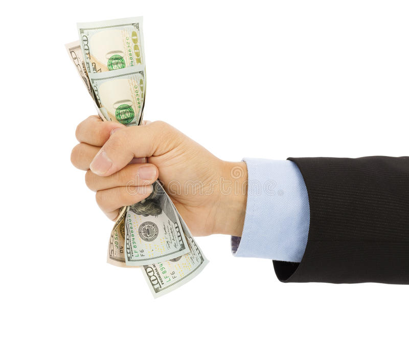 Businessman's hand grasping a handful of dollars stock images