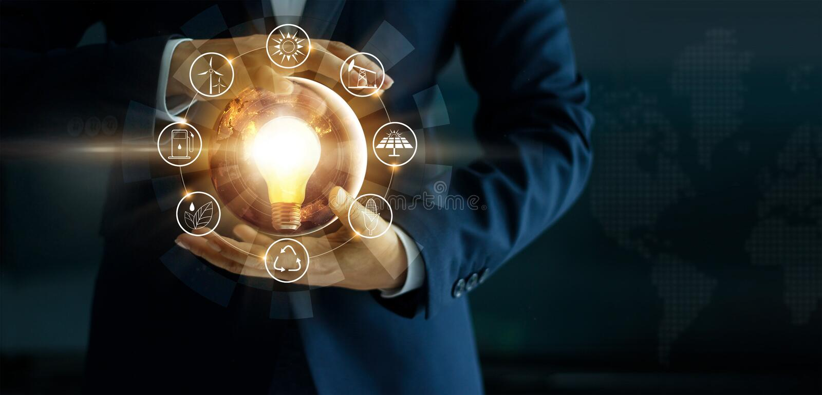 Businessman holding glowing light bulb with energy sources icon stock photography