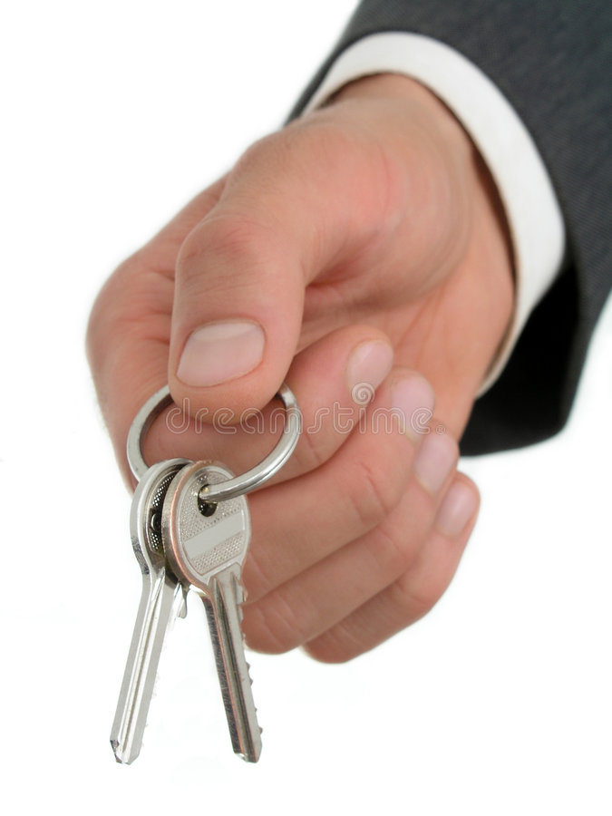 Businessman's Hand Holding Keys stock photo