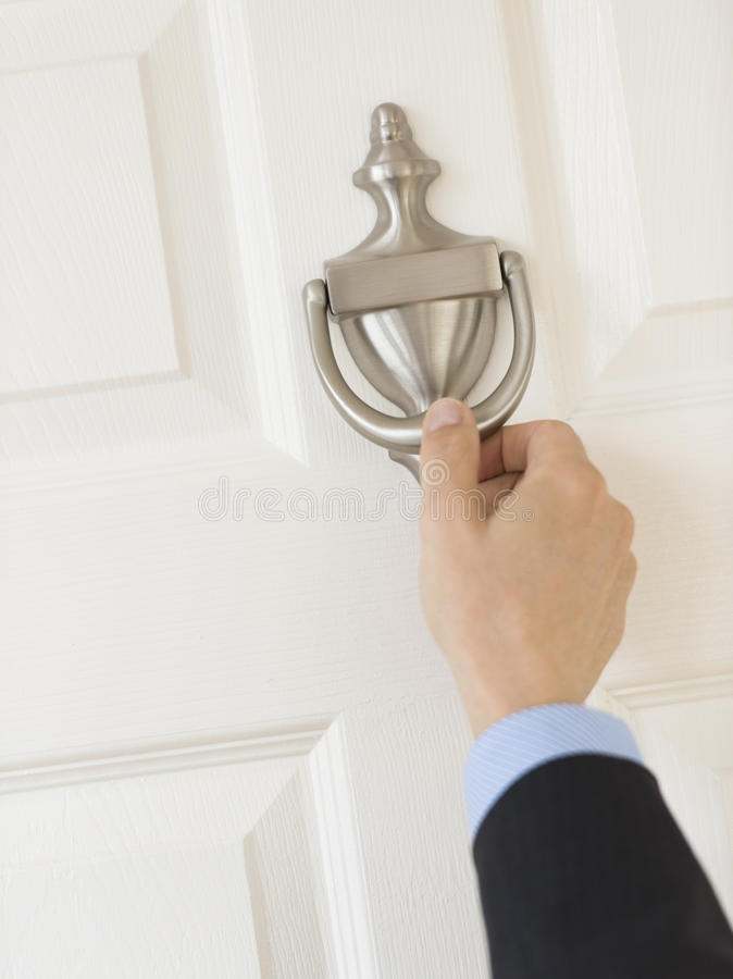 Businessman'S Hand Knocking Door Handle royalty free stock images