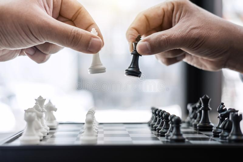 Businessman`s hand playing chess game to development analysis ne. W strategy plan, business strategy leader and teamwork concept for win and success royalty free stock image