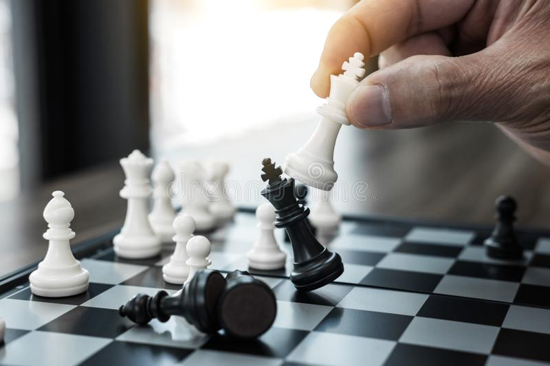 Businessman`s hand playing chess game to development analysis ne. W strategy plan, business strategy leader and teamwork concept for win and success royalty free stock photo