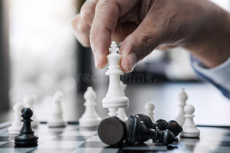 Businessman`s hand playing chess game to development analysis new strategy plan, business strategy leader and teamwork concept fo royalty free stock photos