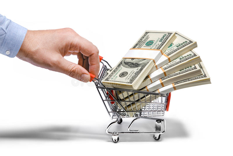 Businessman's hand & steel grocery cart full of money stacks - isolated on white background. Man's hand holds grocery cart full of money stacks - isolated on royalty free stock photography