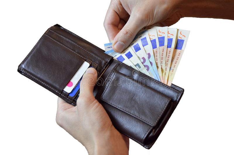 Businessman`s hands holding brown leather wallet full of money isolated over white background stock photo