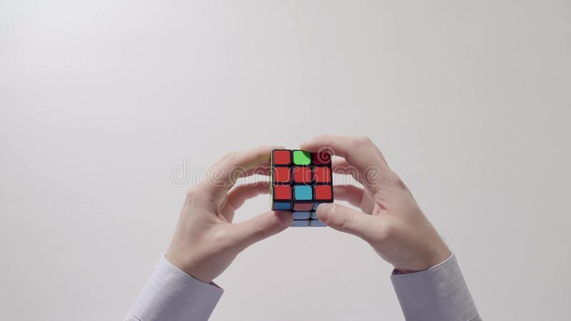 Businessman`s hands solving puzzle. Part 03. Speed up. royalty free stock image