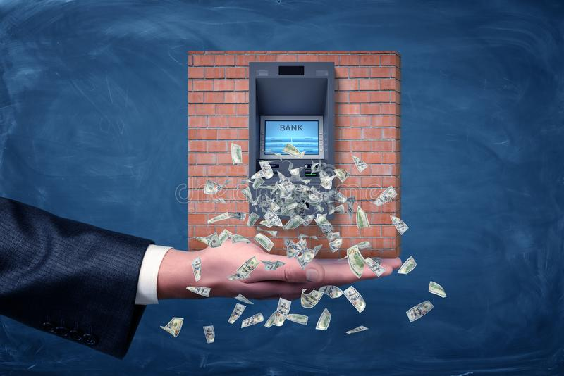 A businessman`s palm holding a piece of a brick wall section with an ATM machine giving out dollar bills. Business and money. Commercial bank. Salary and royalty free illustration