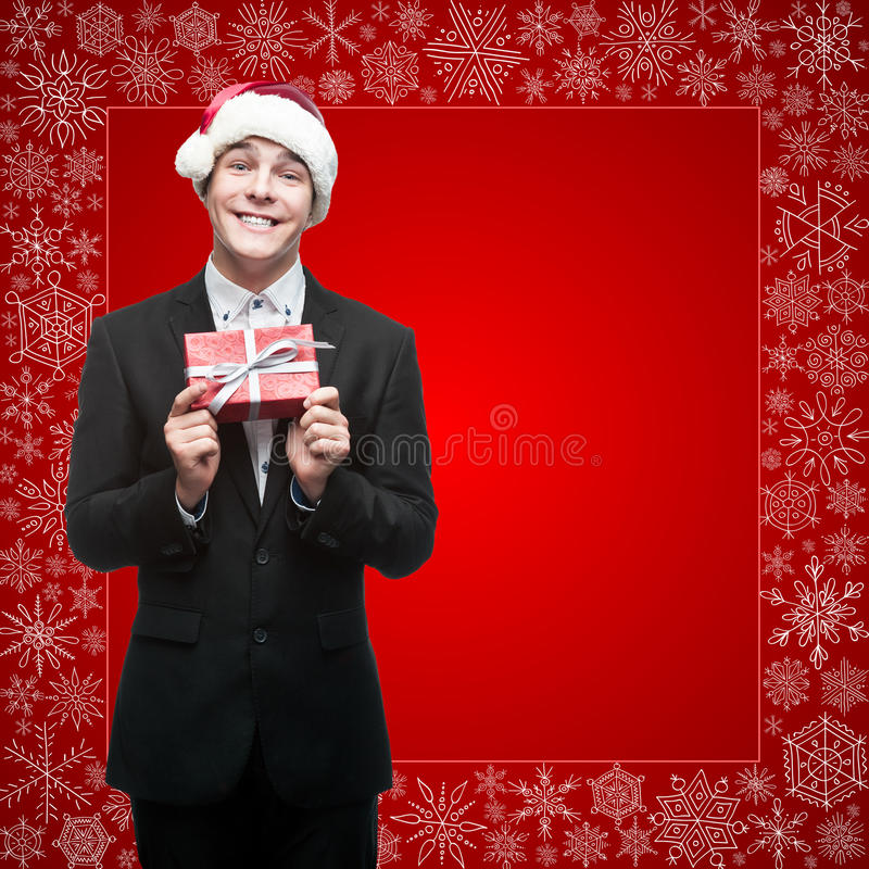 Businessman in santa hat holding gift royalty free stock image