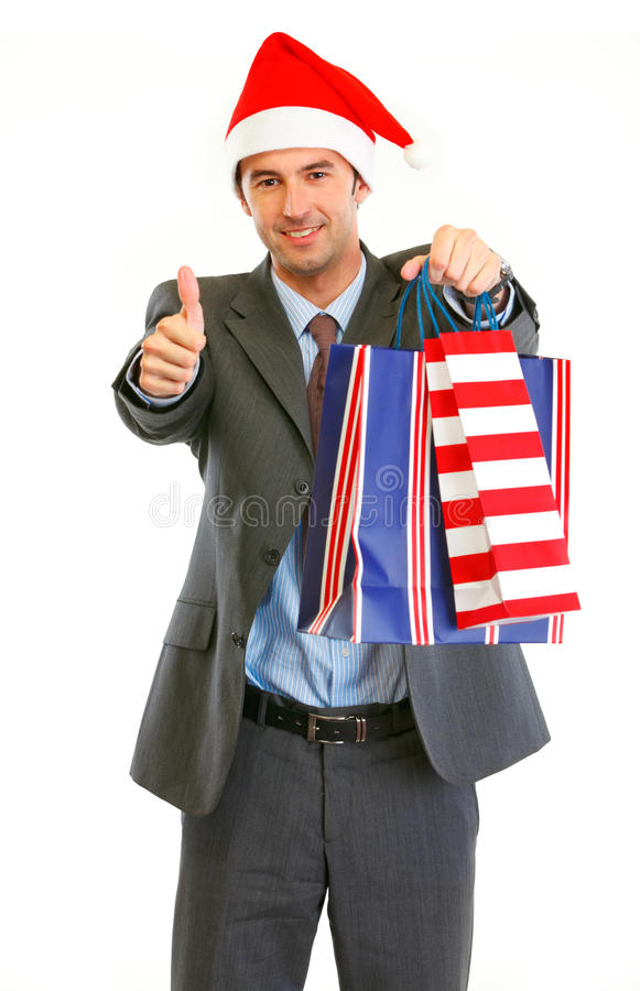 Businessman in Santa Hat with shopping bags royalty free stock images