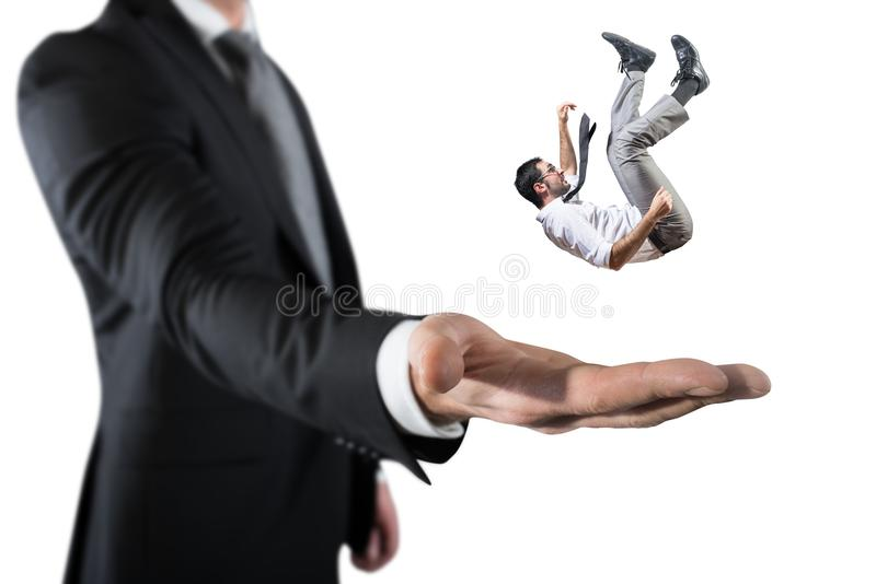 Businessman is saved from a big hand. Concept of business support and assistance. Falling businessman is saved from a big hand. Concept of business support and royalty free stock photo