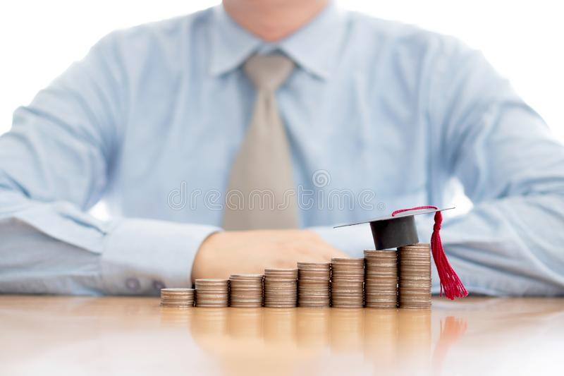 Businessman saveing for eudcation stock photos