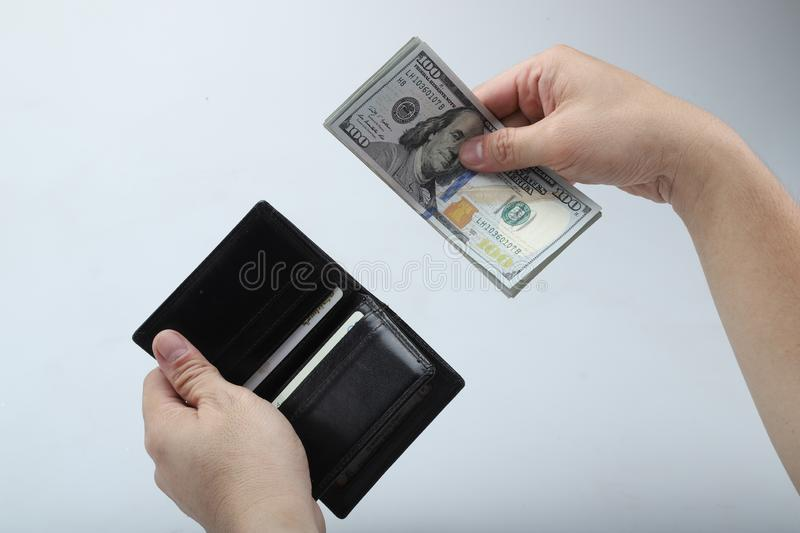 Businessman saving money, Close up man carrying a wallet in hand, the dollar,finance accounting concept royalty free stock photo