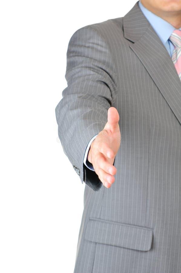 Businessman saying welcome stock image