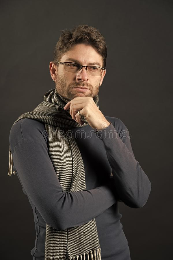 Businessman in scarf and sweater. Man think in glasses on bearded face. Fashion, eyewear, accessory. Business, vision, solution concept. Eyesight correction royalty free stock photos