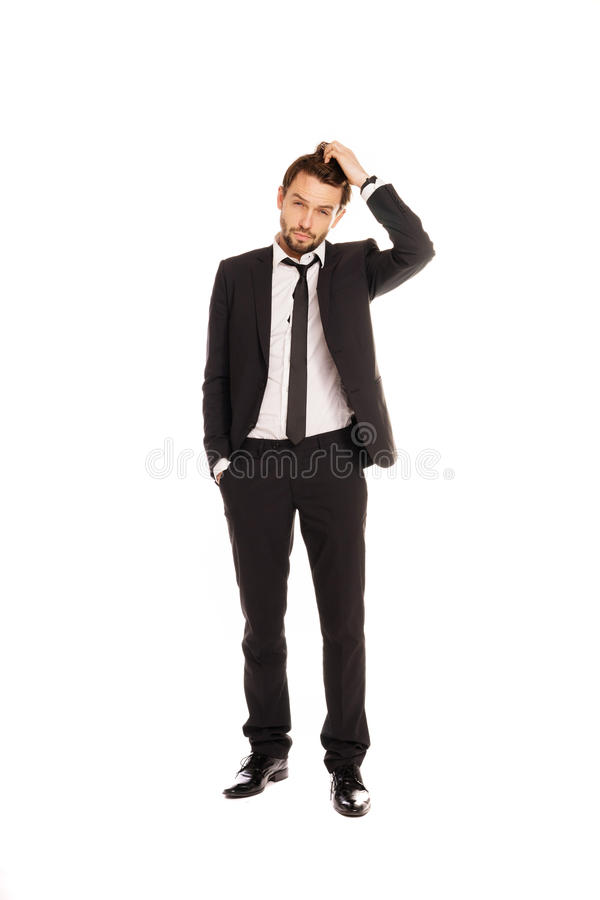 Businessman scratching his head in doubt stock photo