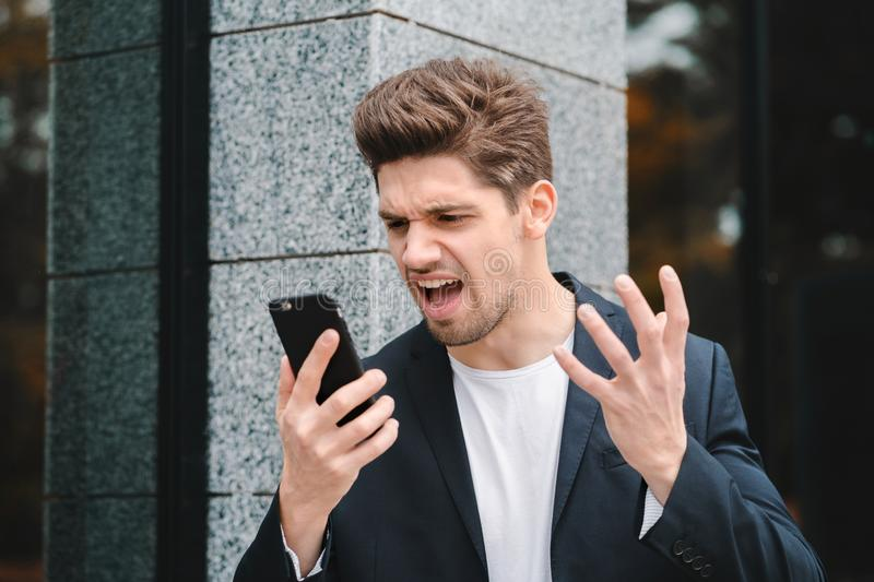 Businessman screaming on mobile phone. Having nervous breakdown at work, screaming in anger, stress management, mental royalty free stock images