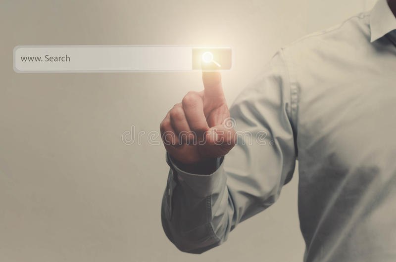businessman search button on virtual touch screen pressed with f royalty free stock images