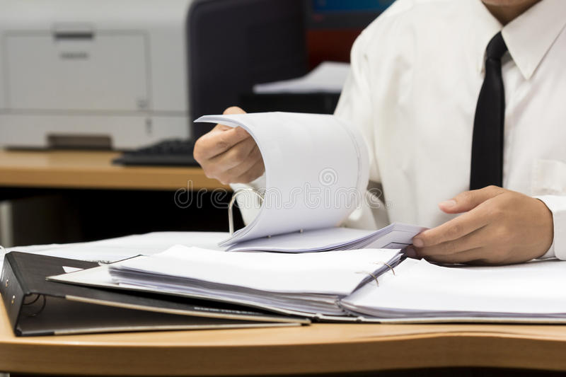 Businessman search in file. Businessman search paper from file stock photos
