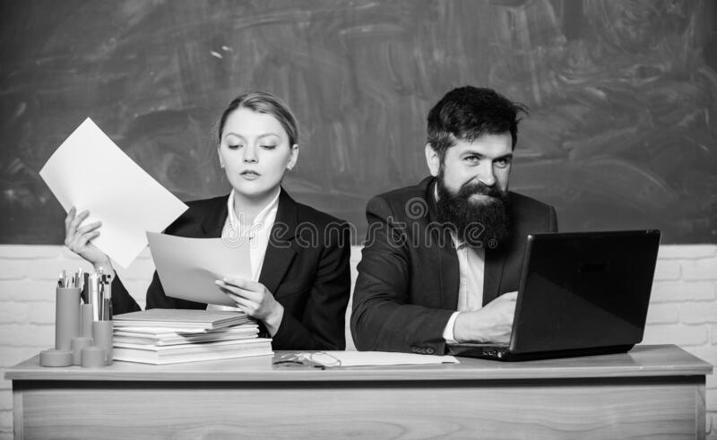 Businessman and secretary. back to school. Formal education. paper work. office life. business couple use laptop and royalty free stock images