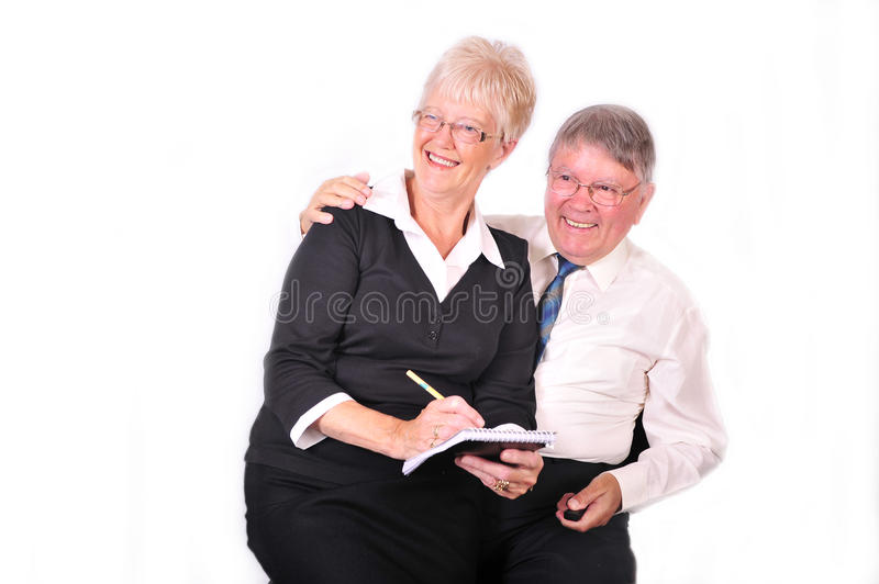Businessman And Secretary Taking Notes Stock Photography
