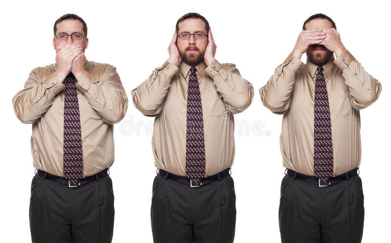 Businessman See No Evil poses. Isolated studio shot of a Caucasian businessman in the See No Evil, Hear No Evil, Speak No Evil poses stock photo