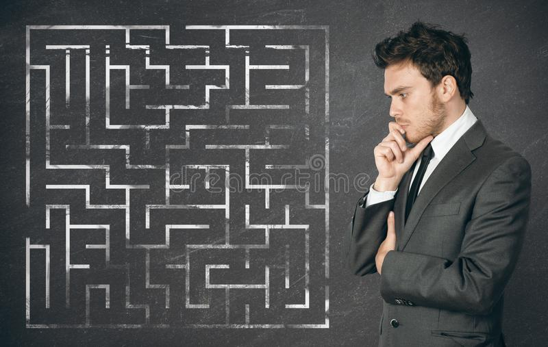 Businessman seek the solution. Of a complex maze stock image