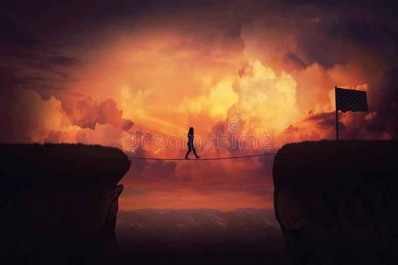 Businessman self overcome. Surreal challenge overcome as woman cross chasm conquering obstacle balancing on slackline rope above the clouds. Way to finish, reach royalty free stock photos