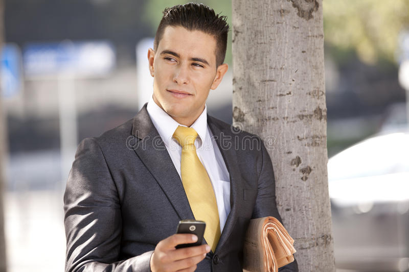 Businessman Sending Messages At The Cellular Royalty Free Stock Images