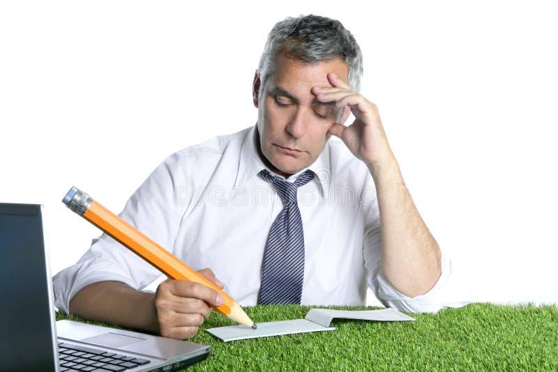 Businessman senior sign check pensively stock photos