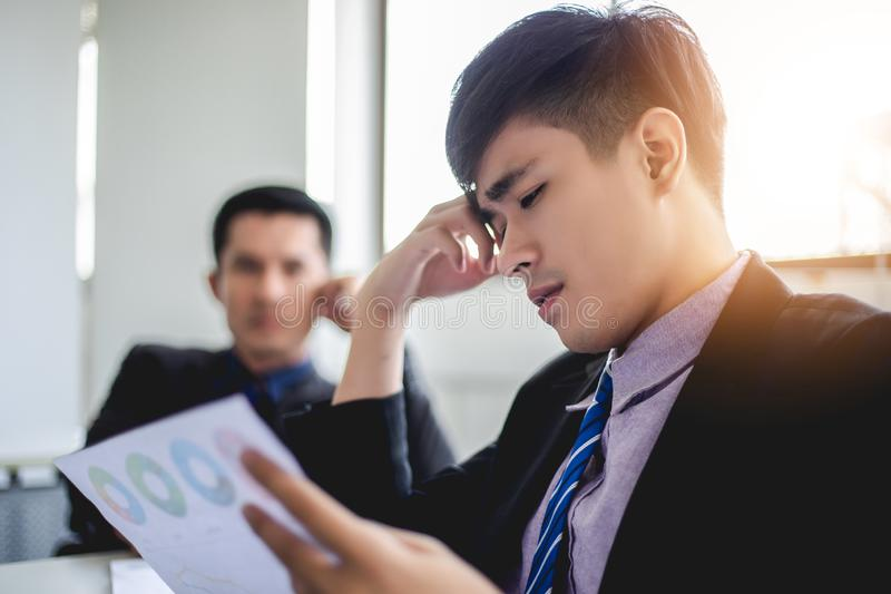 Businessman serious about the  work hard done until the headache royalty free stock photos