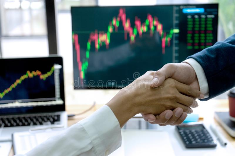 Businessman shake hand at the office. Table between computer laptop , success or agreement about their job, handshake, market, people, meeting, stock stock photography