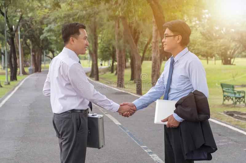 Businessman shaking hands after business meeting in park, Business meeting concept royalty free stock photography