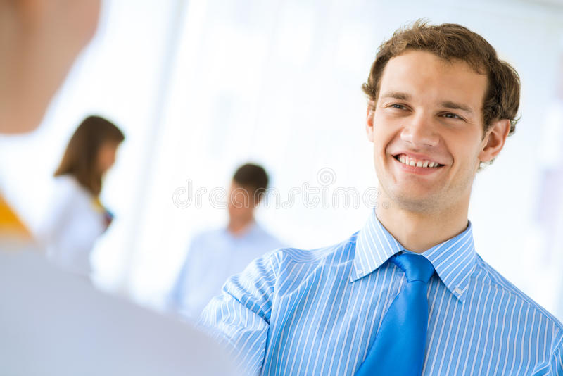 Businessman shaking hands with a colleague. Young businessman shaking hands with a colleague, an agreement royalty free stock photos