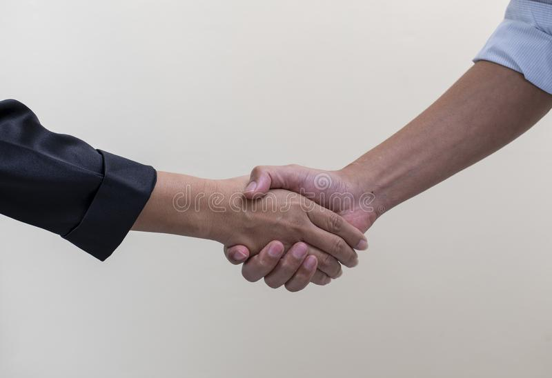 Businessman shaking hands each other, business deal concept stock image