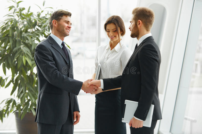 Businessman shaking hands. People shake hands communicating with. Each other stock image