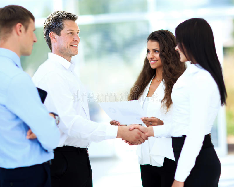 Businessman shaking hands to seal a deal stock images