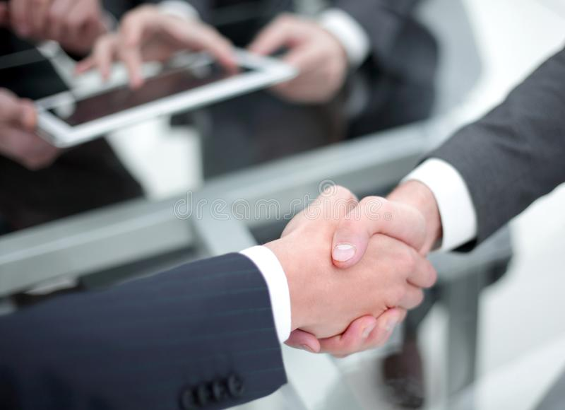 Business men shaking hands. Closeup. Businessman shaking hands to seal a deal with his partner stock image