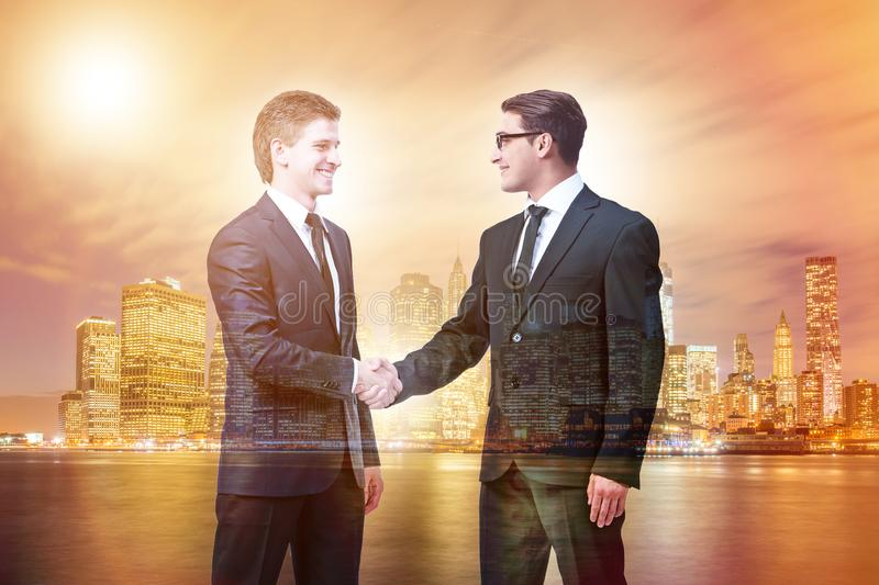Businessman shaking hands in agreement. Businessman shaking their hands in agreement royalty free stock image