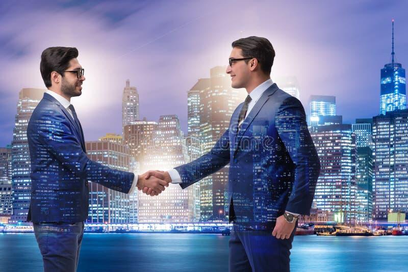 Businessman shaking hands in agreement. Businessman shaking their hands in agreement stock photos