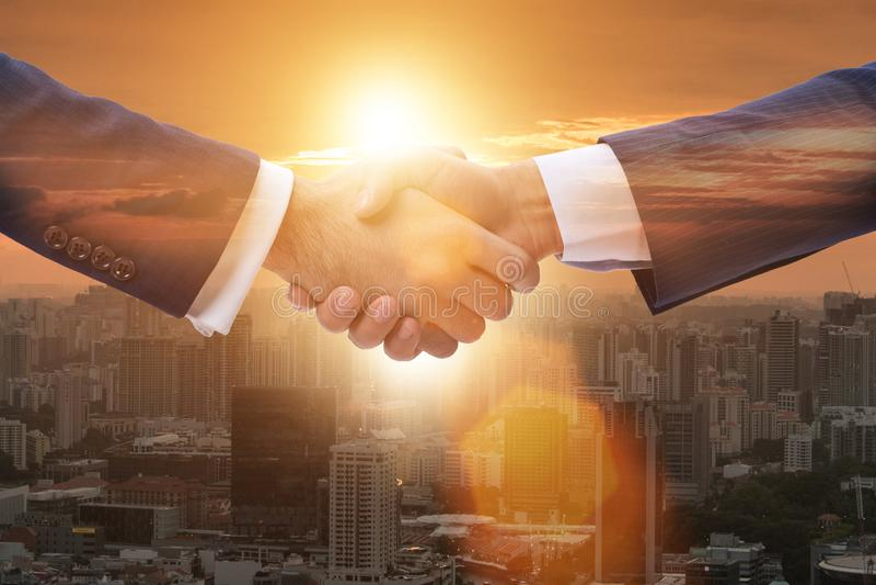 Businessman shaking hands in agreement. Businessman shaking their hands in agreement stock image