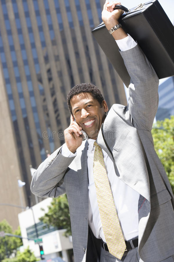 Businessman Sharing His Victory Using Mobile Phone royalty free stock image