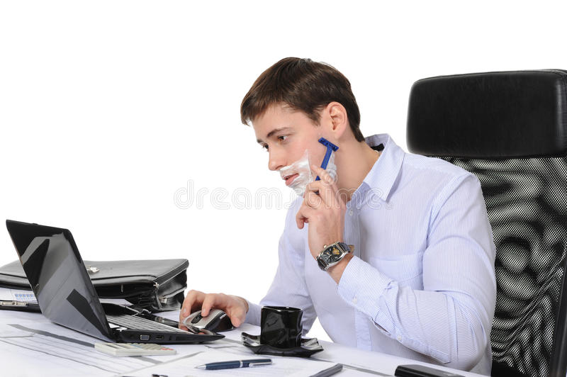 Businessman Shaves In The Workplace Royalty Free Stock Photography