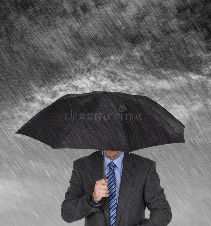 Businessman sheltering royalty free stock images
