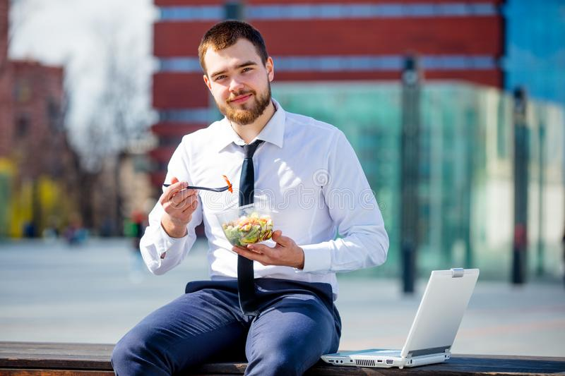 Businessman in shirt and tie with salad lunch box royalty free stock photography