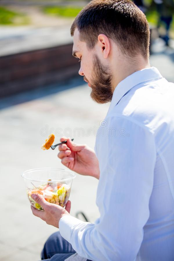 Businessman in shirt and tie with salad lunch box stock images