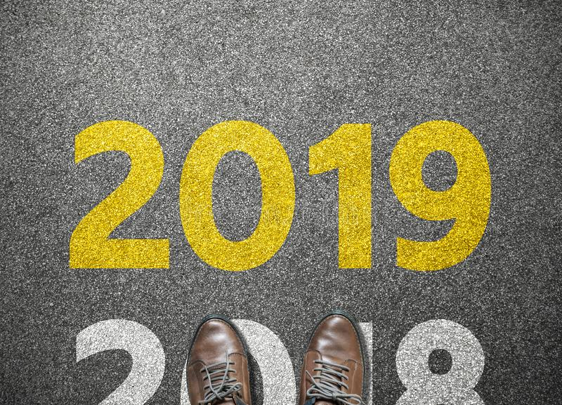 Businessman shoes step to new year with road background royalty free stock photos