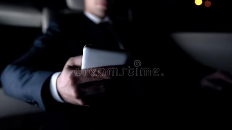 Businessman shopping online while driving home, new mobile application, close up. Stock photo royalty free stock photos